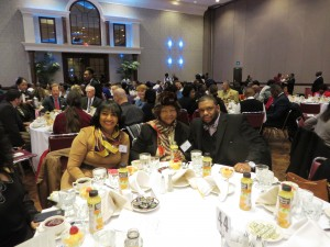 Lena Murrill-Chapman and Everlena Diggs, Greensboro Branch Board Members sitting with Dwayne Shaw, CEO of Heads Up for Our Youth at the January 18 Martin Luther King Breakfast